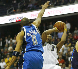 Caron Butler goes for the winning shot, but Shawn Marion denies him of such glory.  (US Presswire)