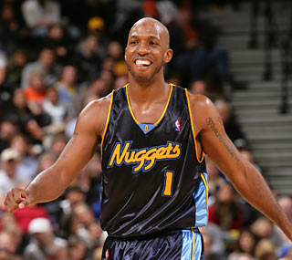 Chauncey Billups lives up to the name 'Mr. Big Shot' by scoring 10 of his career-high 37 in OT.  (Getty Images)