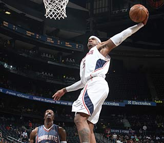 Josh Smith throws down two of his 14 points as the Hawks shoot 51 percent.  (Getty Images)