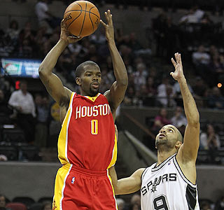 Tony Parker and the Spurs find it hard to slow Aaron Brooks, who scores 23 points.  (Getty Images)