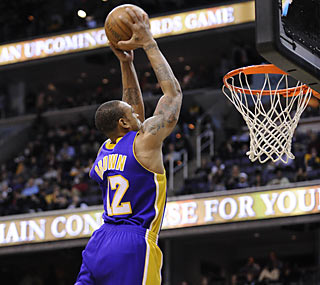Lakers backup point guard Shannon Brown goes airborne for two of his 11 points.  (AP)