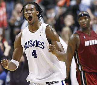 Chris Bosh, donning Toronto's throwback jersey, plays like an animal as he fuels the win over Miami.  (AP)