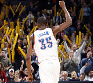 All-Star forward Kevin Durant hypes the crowd by extending his scoring streak. (Getty Images)