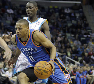 Russell Westbrook coasts with Chris Paul out of New Orleans' lineup as he flirts with a triple-double.  (AP)