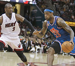 Dwyane Wade and the Heat can't stop LeBron James and the Cavs from winning again. (AP)