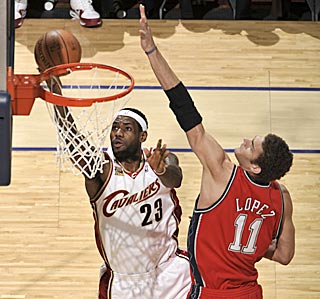 LeBron James vs. Brook Lopez? Mismatch. James drops one of his 13 field goals. (Getty Images)