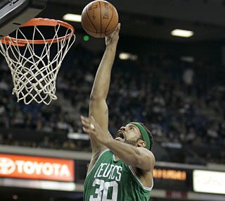 Rasheed Wallace provides 17 points off the Celtics bench, including this jam in the first quarter.  (AP)