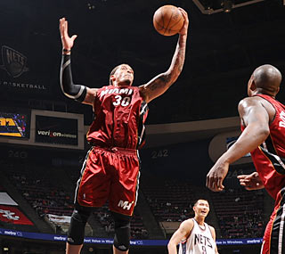 Michael Beasley, who scores a team-high 23 points, steps up for the Heat's fallen star.  (Getty Images)