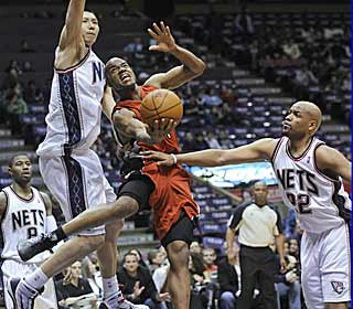 Jarrett Jack cuts between two Nets defenders to put up two of his team-high 18 points. (AP)