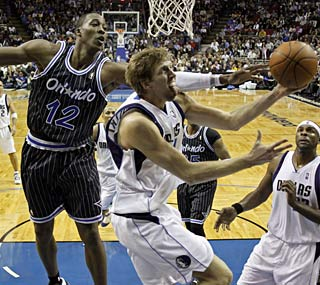 Dirk Nowitzki nets 23 points and the Mavericks notch a big road win in Orlando.  (AP)