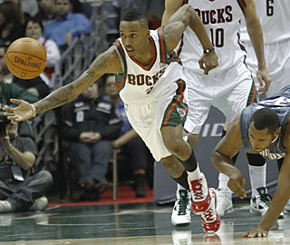 Brandon Jennings scores 19 points to help the Bucks run off with a win at home.  (AP)