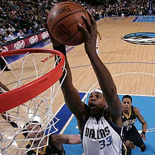 The Mavericks improve to 4-0 with Brendan Haywood in the starting lineup. (Getty Images)