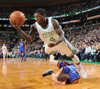 Nate Robinson (four points) makes his Celtics debut, but fails to push around his old team. (Getty Images)