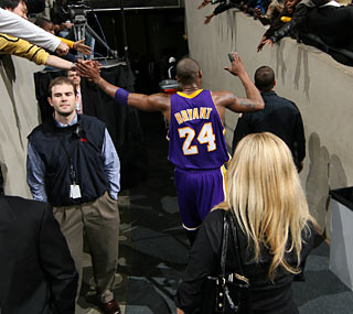Kobe Bryant walks off a hero after returning from a five-game absence. (Getty Images)