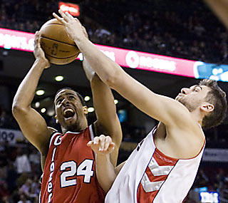The Raptors succeed in blocking Andre Miller from a triple-double. Earning a win is a different story.  (AP)