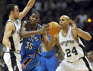 Manu Ginobili (left) and Richard Jefferson help harass Kevin Durant into a 7-for-19 game from the field.  (AP)