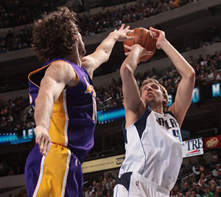 Dirk Nowitzki shoots 10 for 19 from the floor and leads all scorers with his 31-point effort.  (Getty Images)