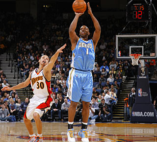 Chauncey Billups makes six 3-pointers to lead the way for Denver with 37 points.  (Getty Images)