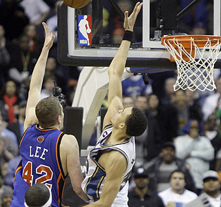 Count it. David Lee puts up the winning basket over the outstretched arm of JaVale McGee. (AP)