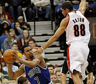 Nicolas Batum not only plays tight defense, but also adds a career-high 31 points.  (AP)