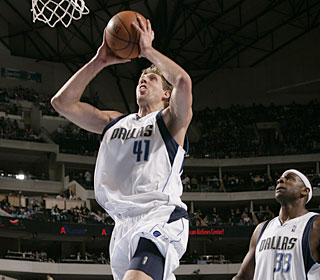 Dirk Nowitzki scores two of his 36 points -- his third straight game of at least 30 points.  (Getty Images)