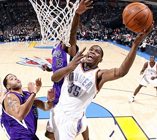 Kevin Durant scores at will against the Kings, notching 39 points with 10 rebounds.  (Getty Images)