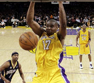 Andrew Bynum has 16 points as the Lakers improve to 14-0 against the Pacers at Staples Center.  (AP)