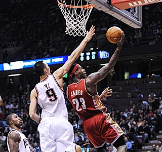 LeBron James can do little wrong against New Jersey, including making this reverse layup.  (US Presswire)