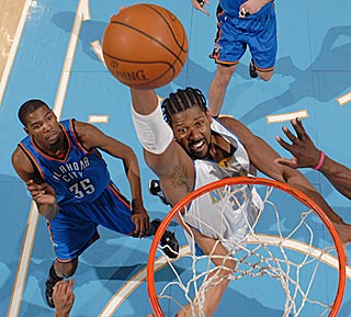 Kevin Durant is reduced to a mere mortal as he watches a soaring Nene throw it down.  (Getty Images)