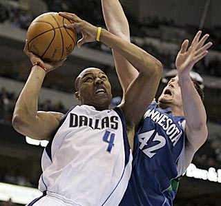 Dallas forward Caron Butler muscles his way past Minnesota's Kevin Love in the second half.  (AP)