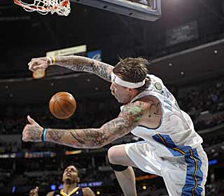 The Birdman enjoys some air time after throwing down a dunk against the Pacers. (AP)