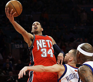 Devin Harris notches 31 points to help the Nets earn their third straight road victory.  (AP)