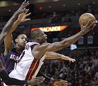 With three players out, Dwyane Wade steps up and goes for 38 points and 10 assists. (AP)