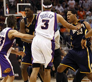 The Suns' 1,900th win in franchise history is marked by two fights and eight technical fouls.  (AP)