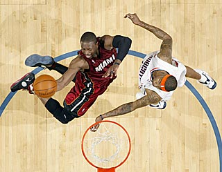 Dwyane Wade scores a game-high 27 points, but can't will the Heat past the upstart Bobcats.  (Getty Images)