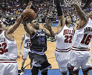 Vince Carter slices through the Bulls defense to score two of his game-high 23 points. (AP)