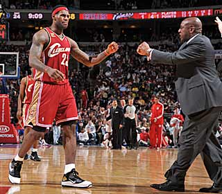 Although he only missed two games, Mike Brown seems happy to have LeBron back. (Getty Images)