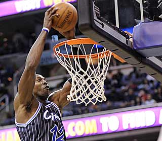 Dwight Howard rises way above the rim to throw down two of his team-high 28 points. (AP)