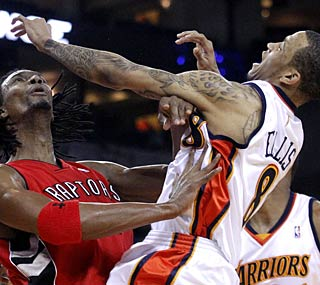 The Warriors' Monta Ellis gets pushed around but still manages to drop 31 on the Raptors. (US Presswire)