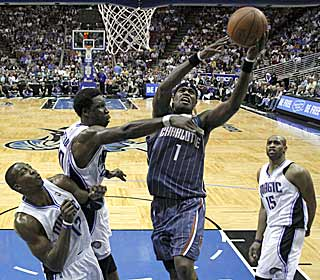 Stephen Jackson rolls through the lane, catching the Magic defense off guard.  (AP)