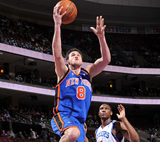 Get out of the way! New York's Danilo Gallinari slices through the 76ers for 21 points.  (Getty Images)