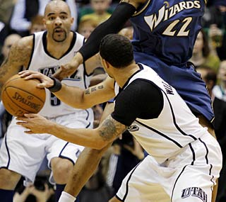 Deron Williams and Carlos Boozer are a formidable duo, helping the Jazz coast past the Wizards.  (AP)