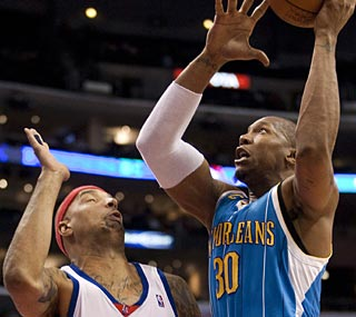 David West rules the paint with 24 points and the Hornets end their road losing skid.  (AP)