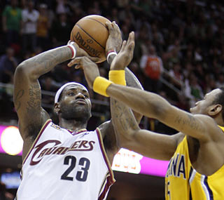 LeBron James  (32 points, nine boards, nine dimes) nearly records his second straight triple-double.  (AP)