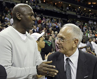 New Bobcats majority owner Michael Jordan praises head coach Larry Brown on a job well done.  (AP)