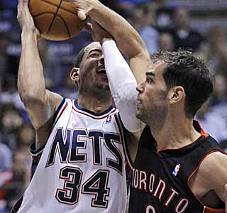 Jose Calderon and the Raptors smack down any chance of the Nets getting their eighth win. (AP)