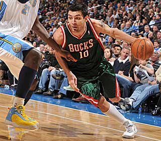 The Bucks pick up a tough road win in Denver behind 26 points from Carlos Delfino. (Getty Images)