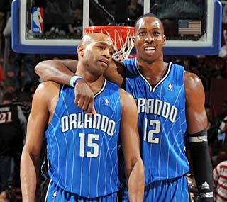 Vince Carter and Dwight Howard have reason to smile as Orlando racks up win No. 50.  (Getty Images)