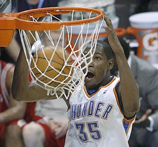 Kiss the rim, Joe Durant. This third-quarter dunk helps the Thunder maintain a comfortable lead.  (AP)