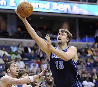 Mehmet Okur provides 22 points and 11 rebounds to help keep the Wizards winless in March.  (AP)